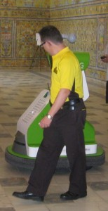 Just kept missing this security guard patting the robot ...