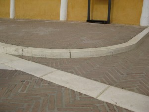 one of the curbs before the covered walkway