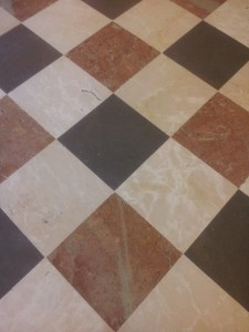 three colours of marble laid close in a regular pattern - no gaps
