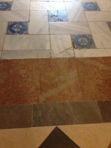transition from marble tiles to marble tiles with glazed tile patterns